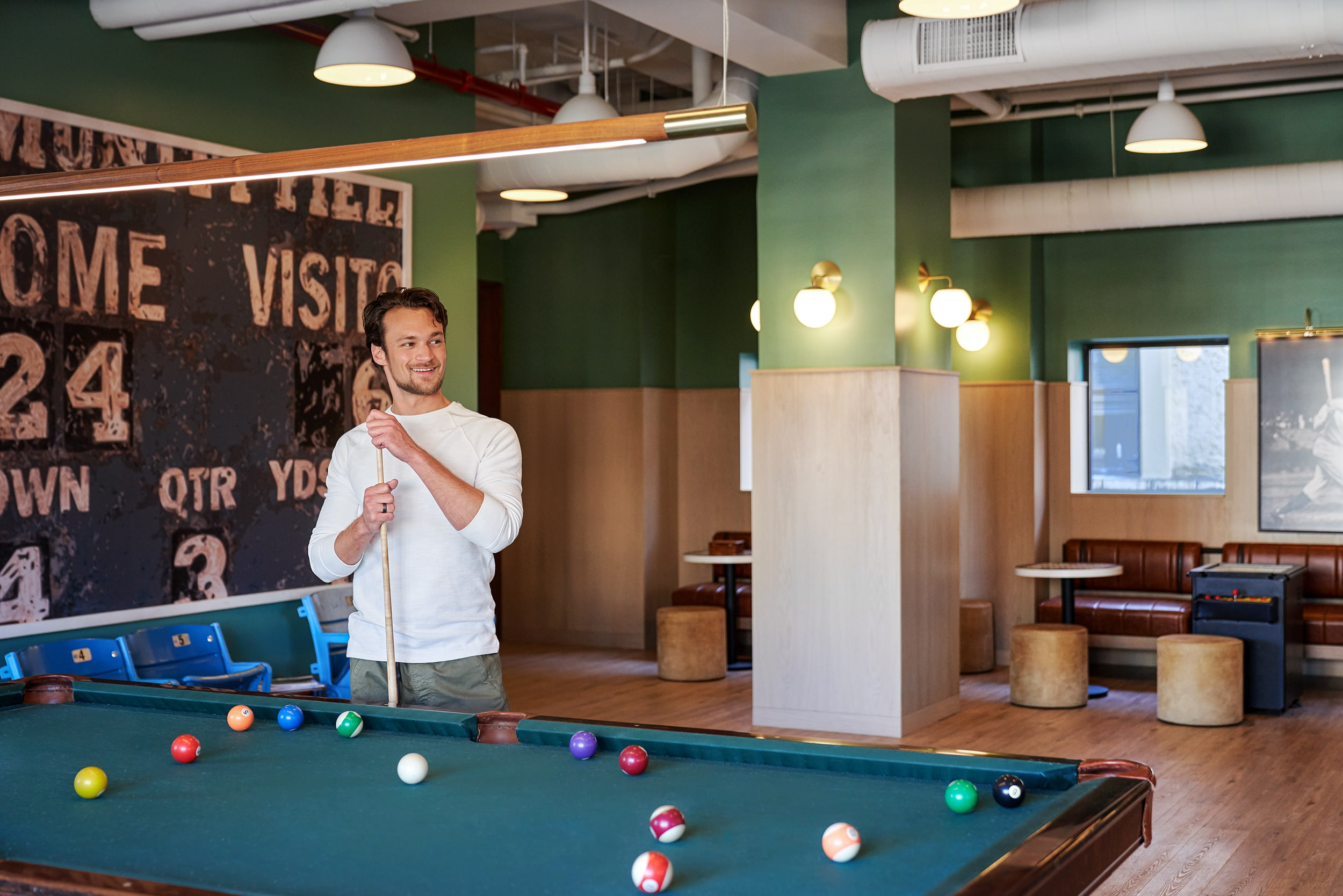 Resident standing at pool table