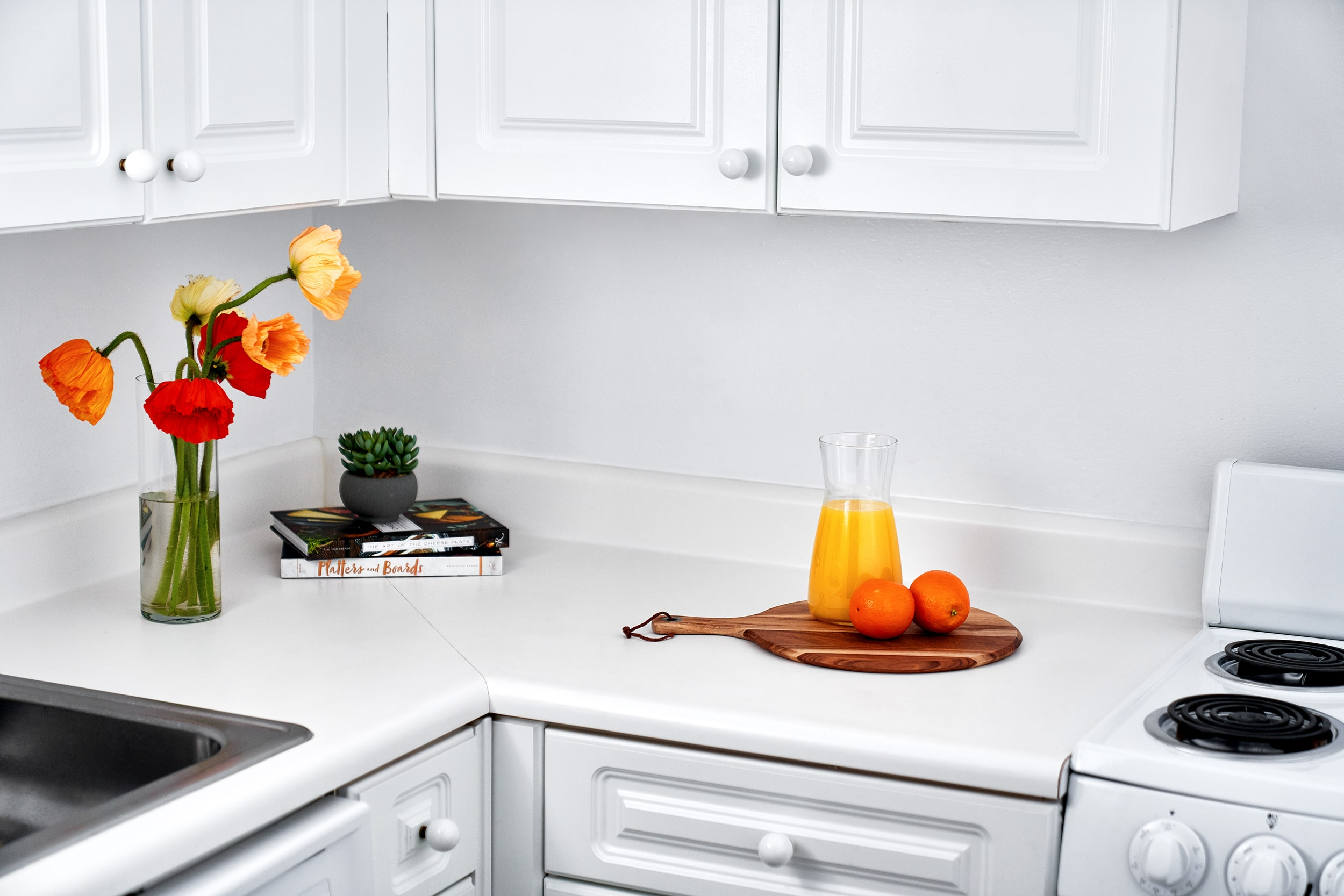 Kitchen with flowers and fruit