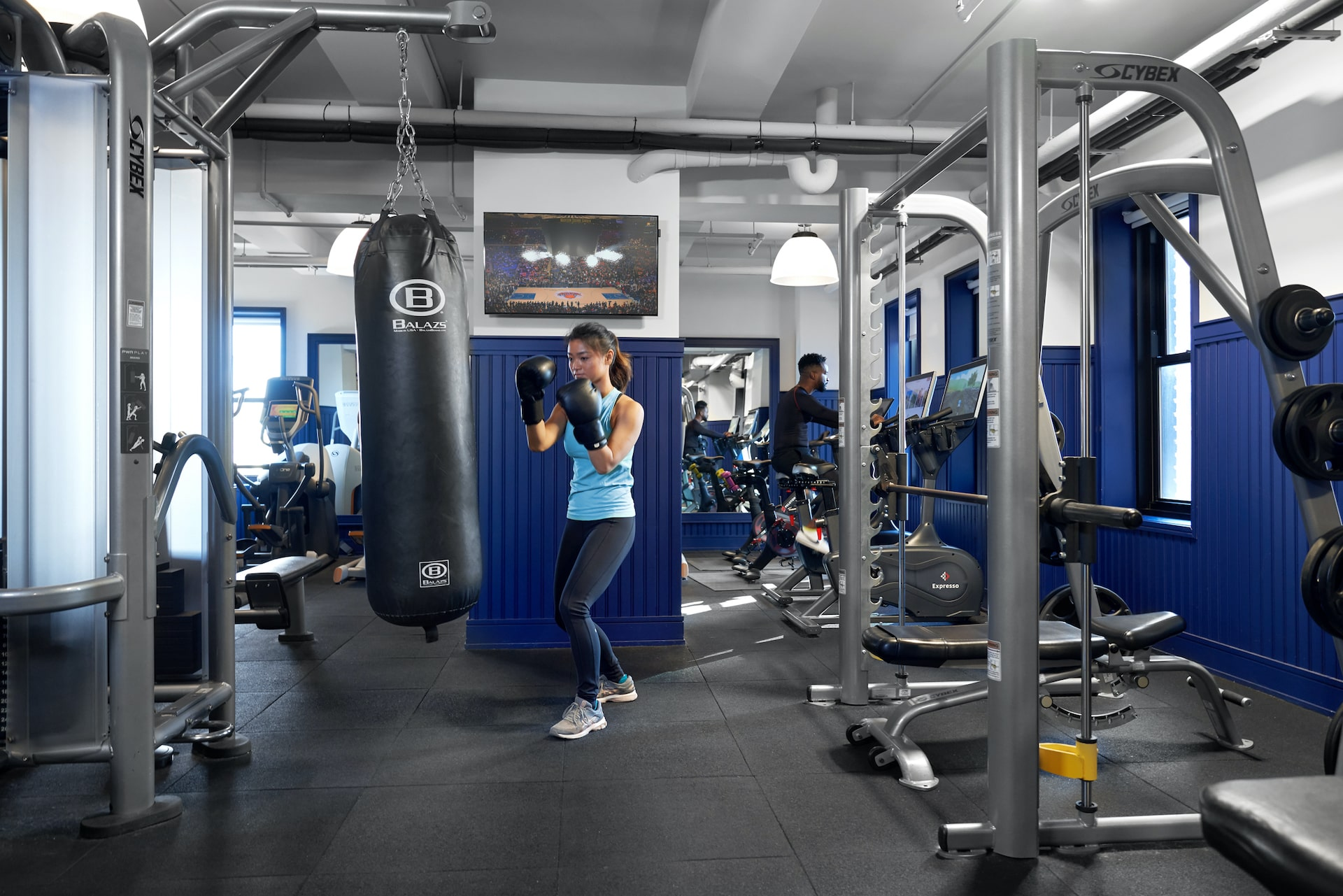 Woman hitting punching bag in the gym